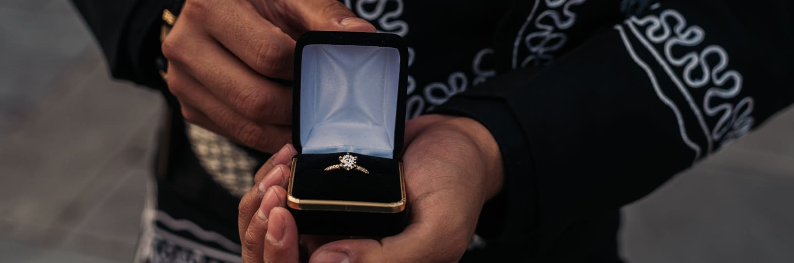 Proposal with a simulated diamond engagement ring
