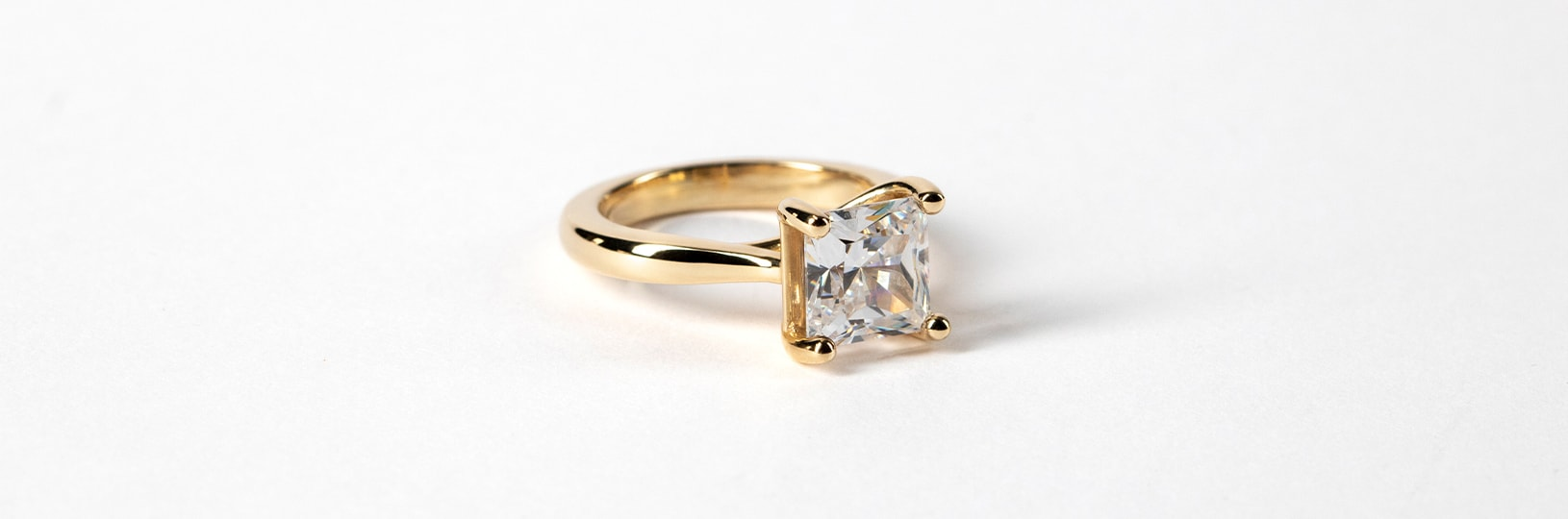 small yellow gold engagement ring
