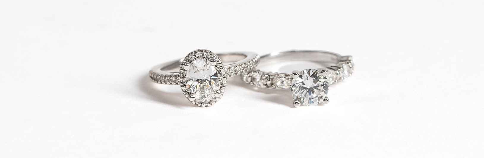 Two engagement rings compared side by side