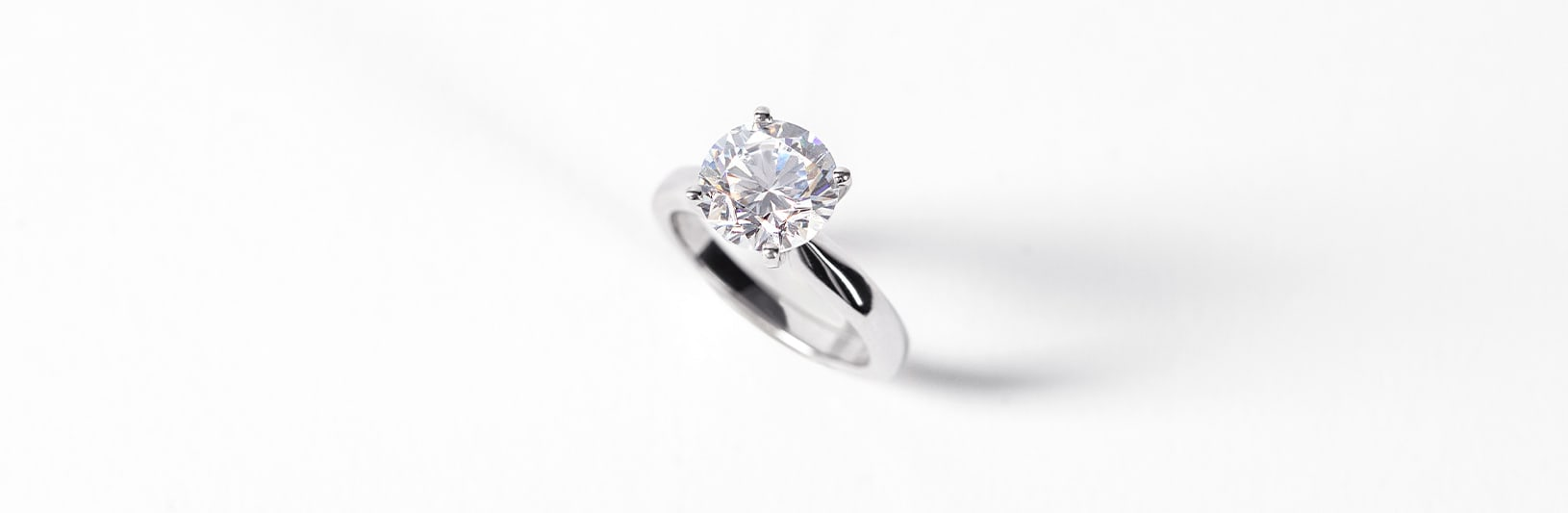 A solitaire engagement ring with a round cut Nexus Diamond™ alternative