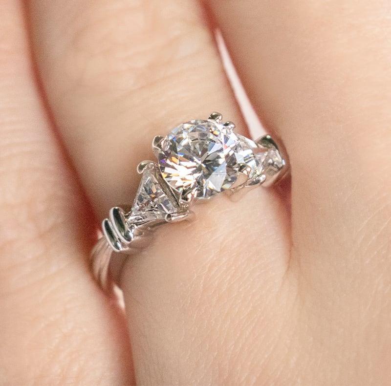 The romantic three stone engagement ring setting