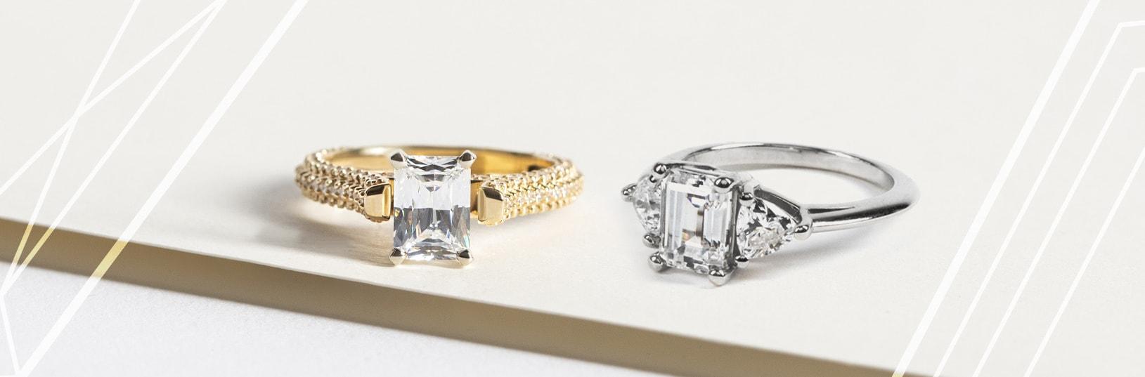 Two emerald cut Nexus Diamond™ alternatives shown side by side