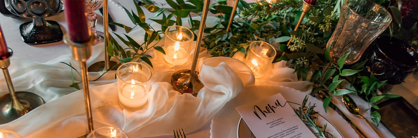 Wedding table centerpiece with name tag and candles