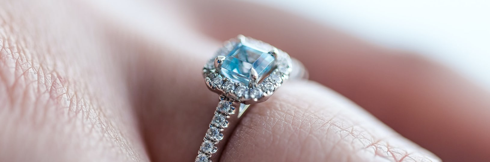 light blue accented engagement ring
