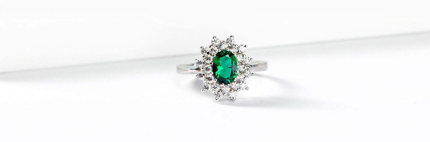 Halo emerald engagement ring