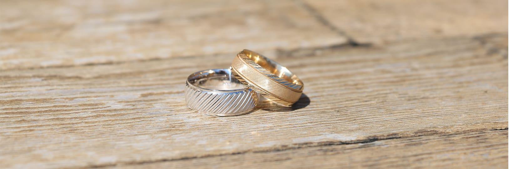 Men's white gold wedding ring and men's yellow gold wedding ring