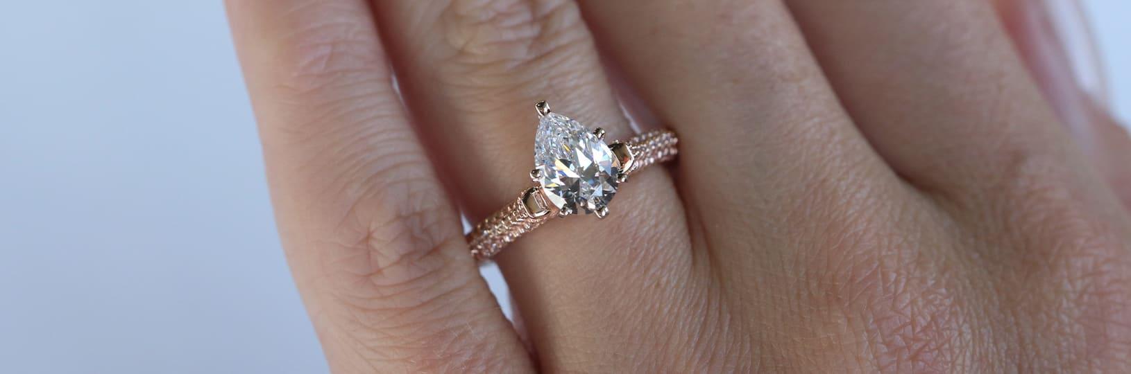 Pear cut pavé engagement ring