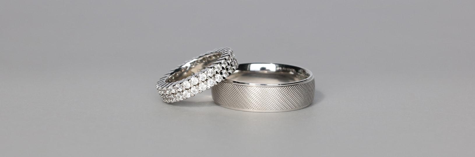Women's eternity ring and men's classic wedding ring