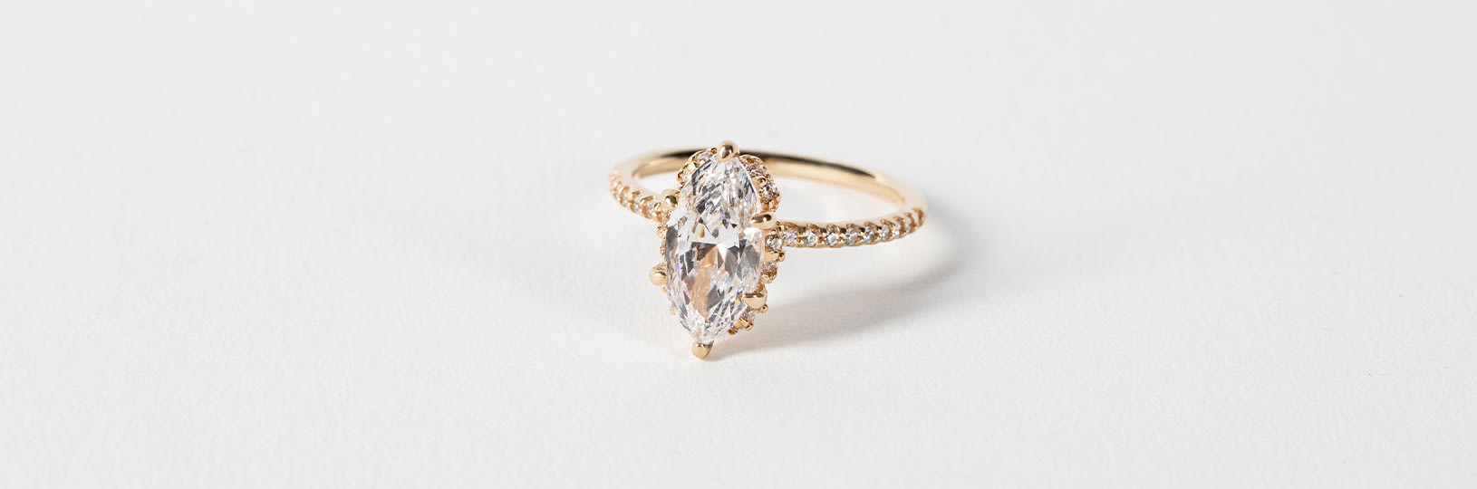 A gold ring featuring a marquise cut stone