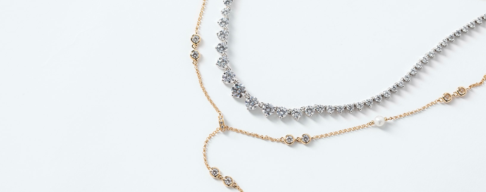 Two necklaces featuring lab grown diamond alternatives