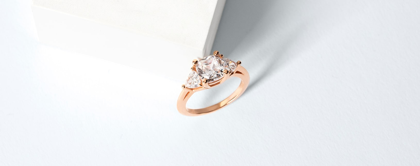 A classic three stone setting with a princess cut diamond alternative center stone