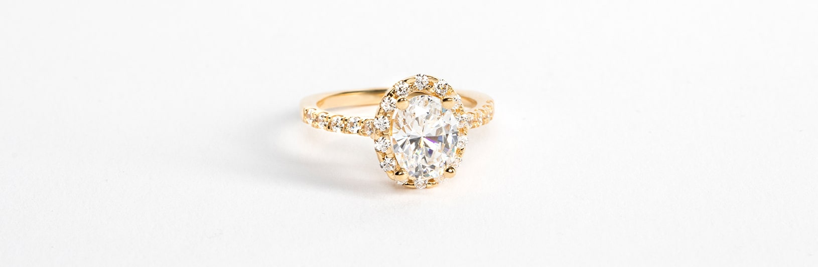 A classic oval cut simulated diamond in an accented setting