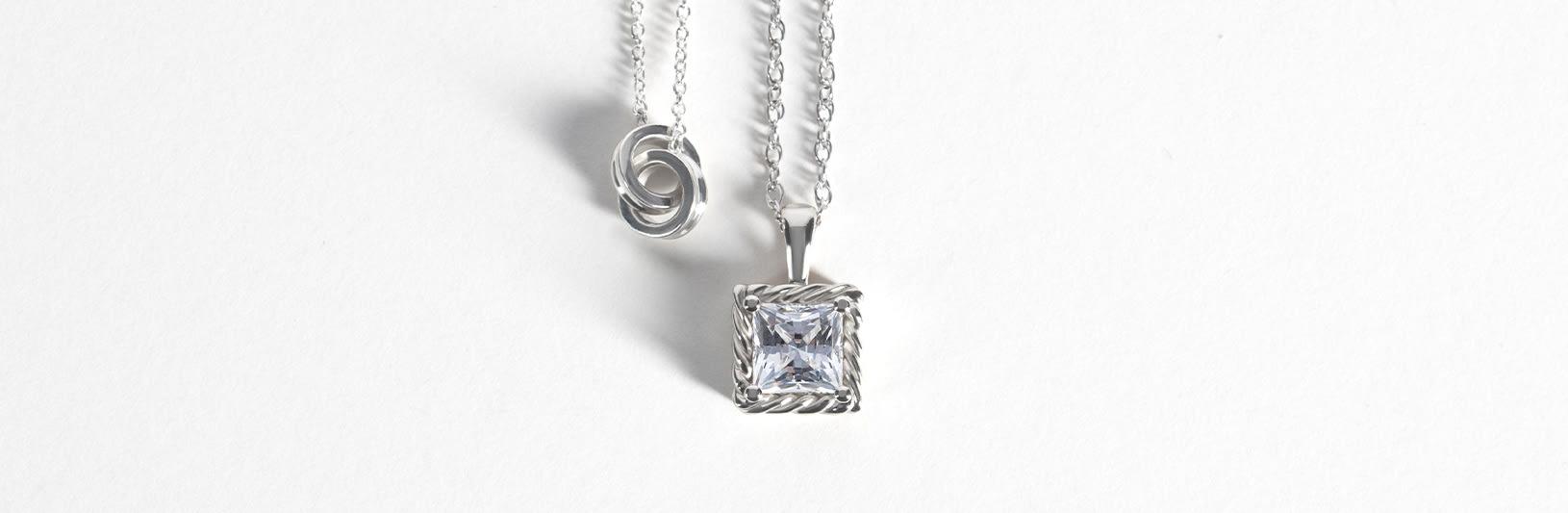 A princess cut simulated diamond pendant
