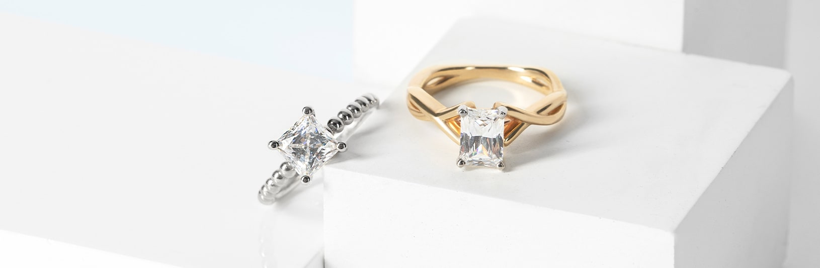 A princess cut stone compared to an emerald cut stone