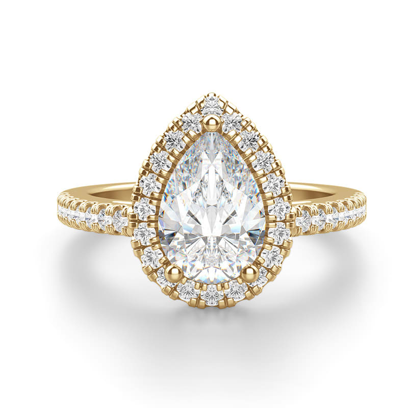 An emerald cut stone in a solitaire engagement ring setting