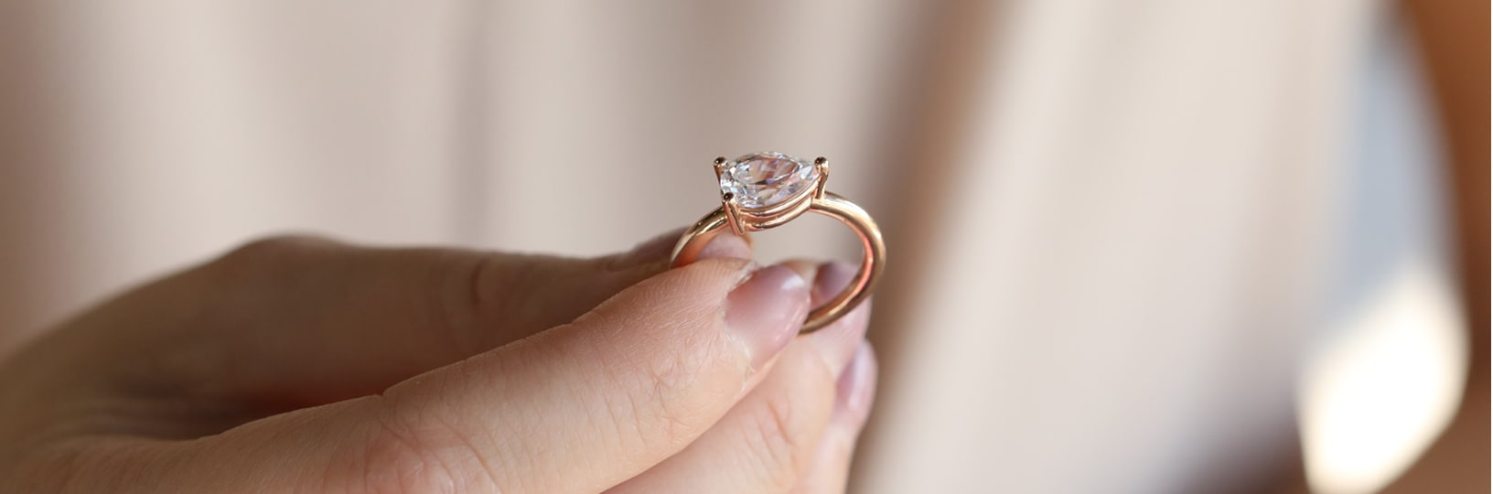 An emerald cut engagement ring in a three stone setting