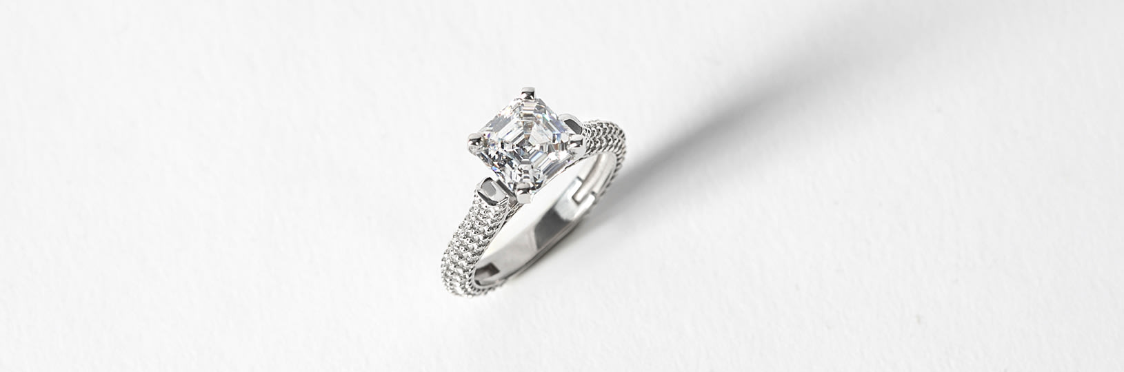 A sliver engagement ring in an accented setting