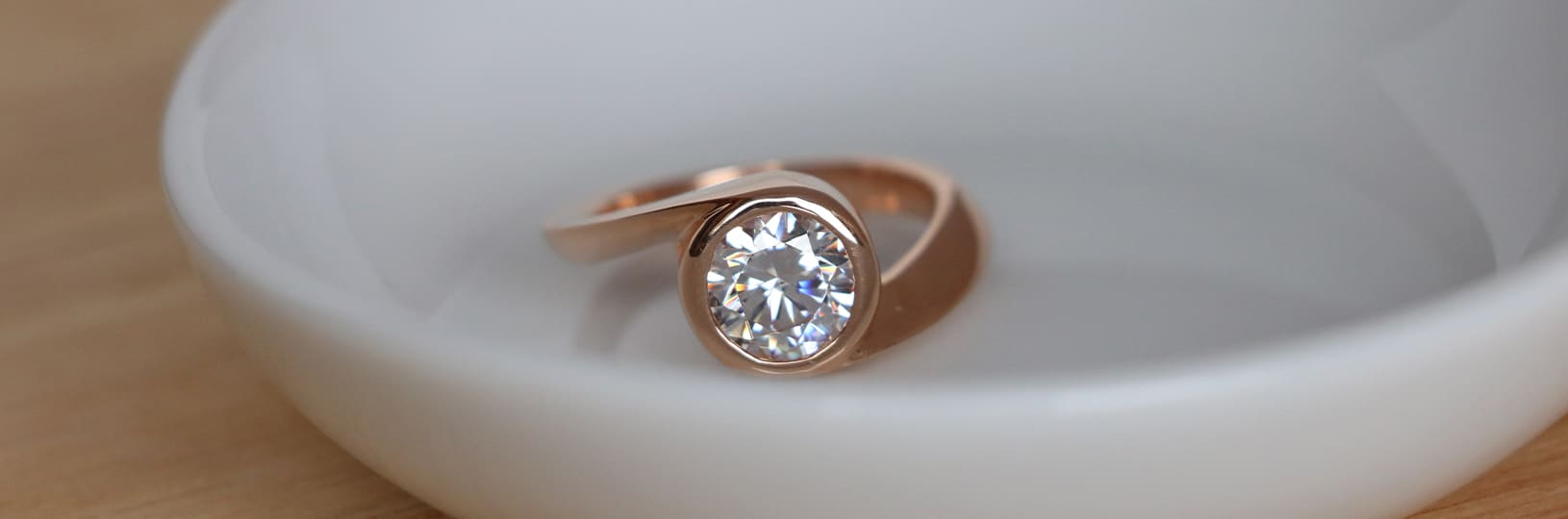 An engagement ring with a bezel setting