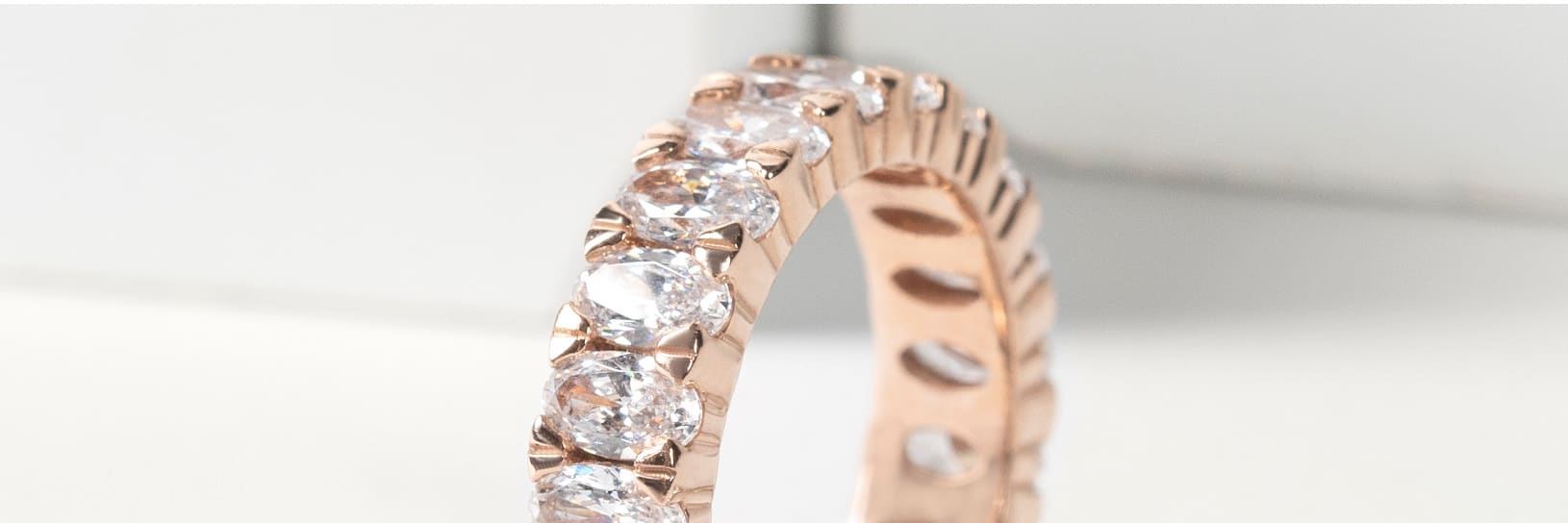 An accented rose gold wedding band