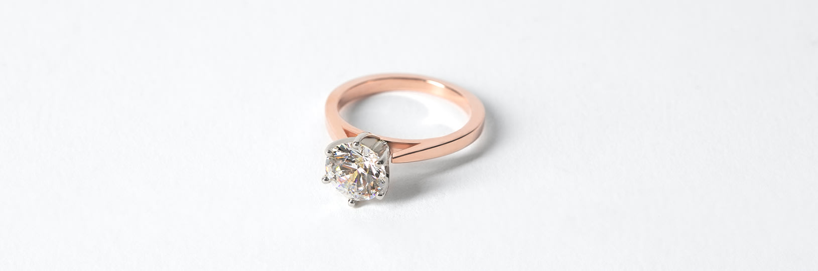 A solitaire rose gold engagement ring