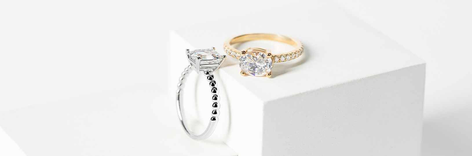 A white gold ring and a yellow gold ring