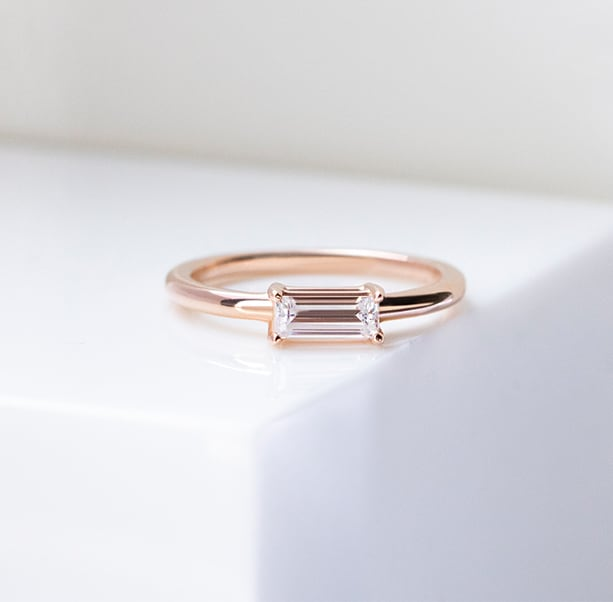 An engagement ring featuring a baguette stone