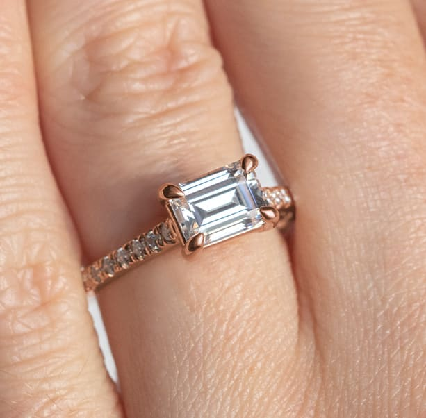An engagement ring with statement prongs and an emerald cut stone