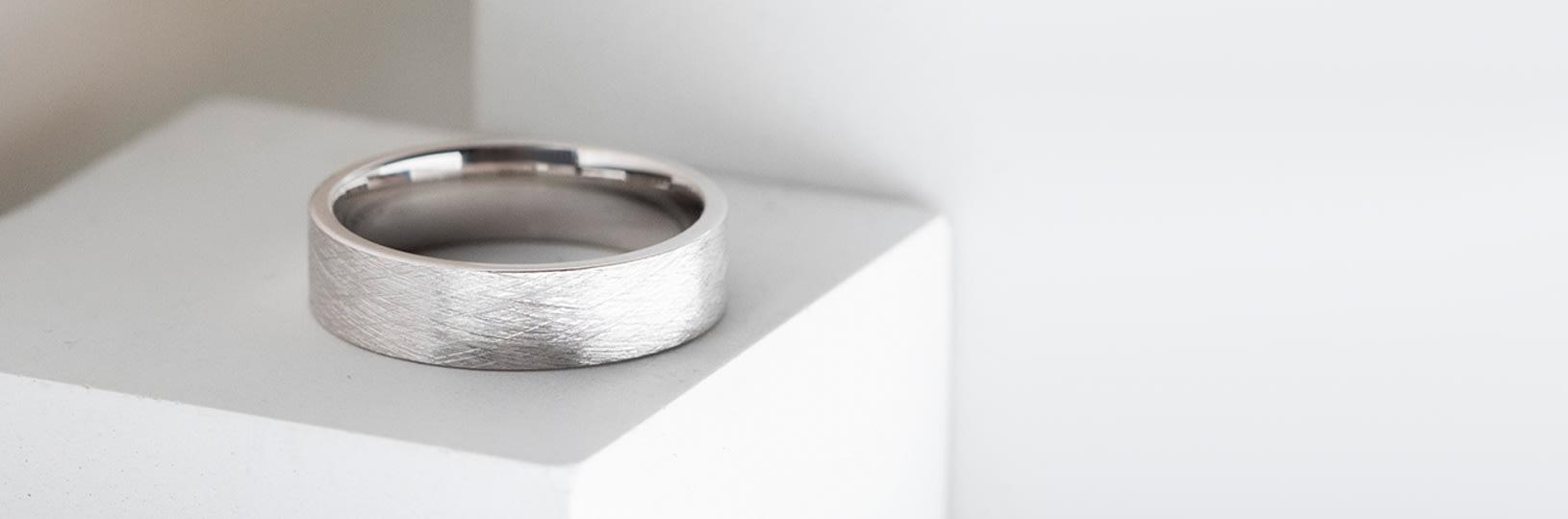 A men's wedding band in titanium
