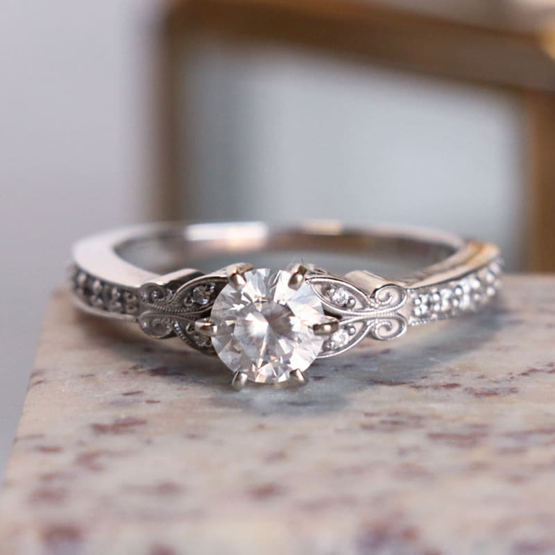 Round cut stone in a vintage setting
