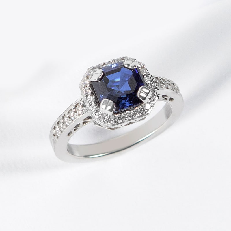 A sapphire stone in a halo setting