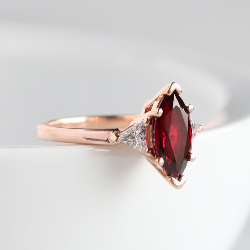 A ruby stone in a solitaire setting