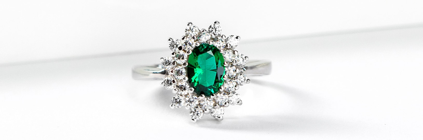 An emerald stone in a halo setting