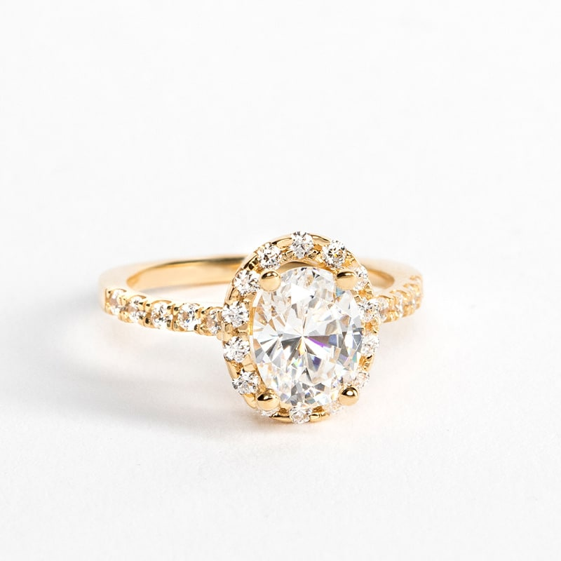 A yellow gold halo engagement ring