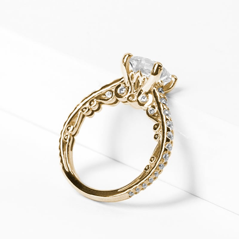 An ornate yellow gold vintage engagement ring