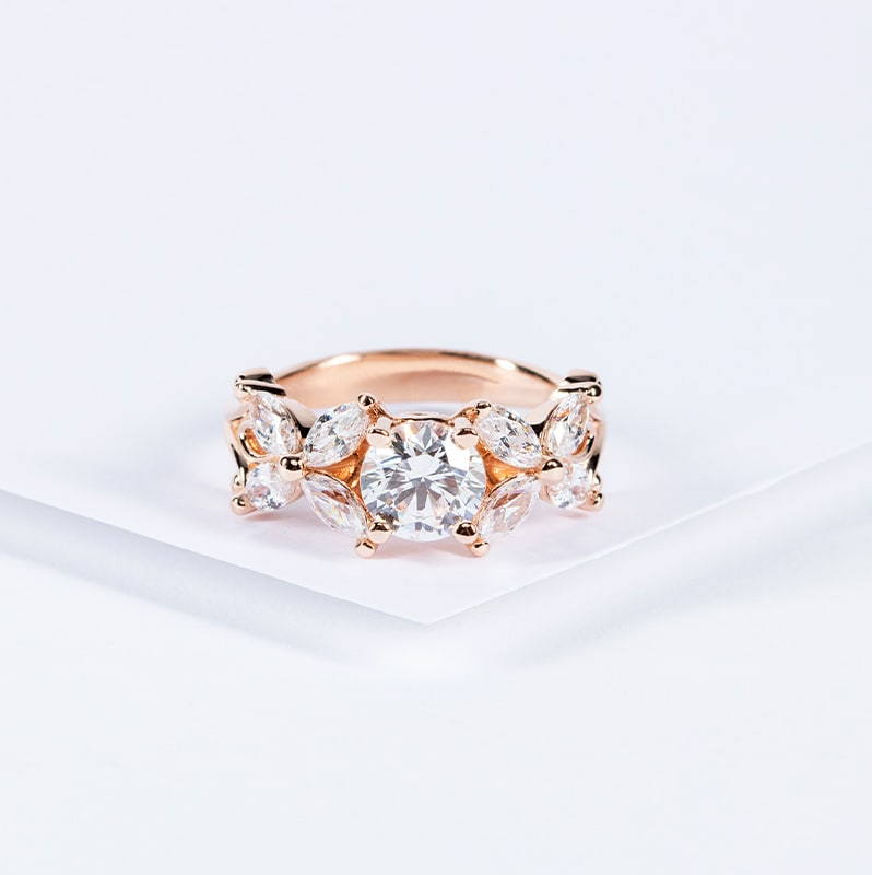 Rose gold engagement ring with marquise accent stones