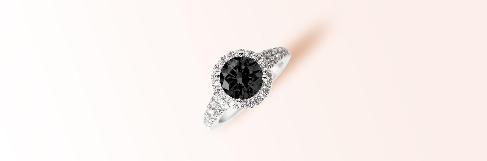Photo of a black diamond engagement ring.