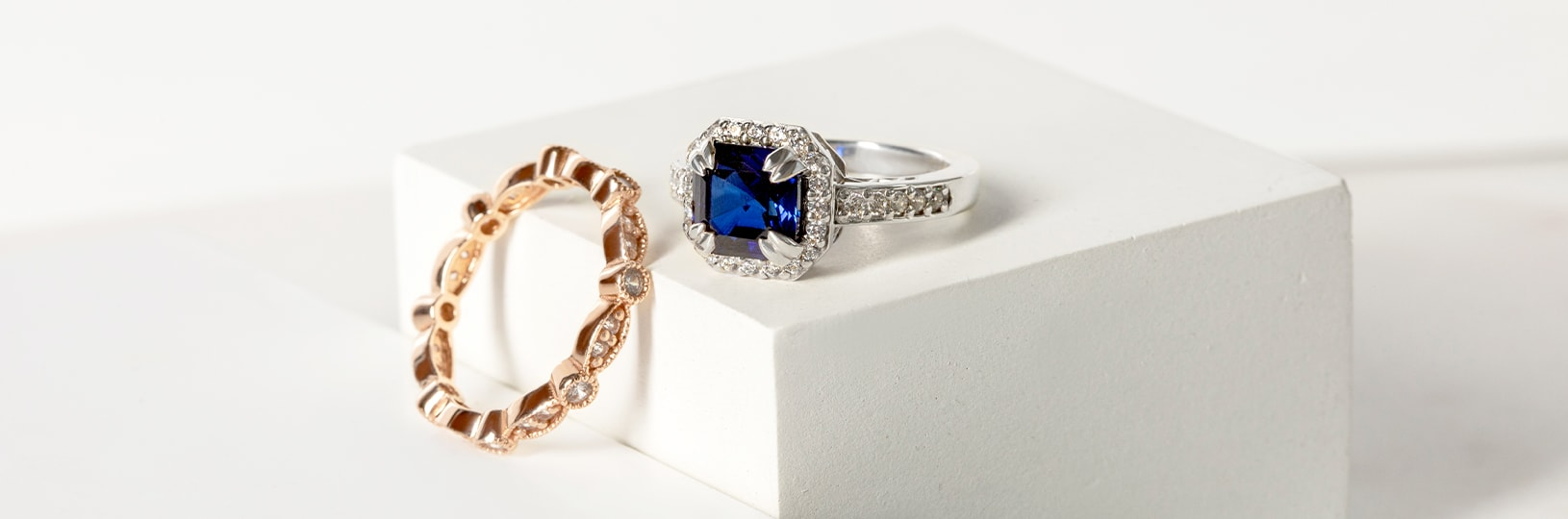 A yellow gold ring and a white gold ring