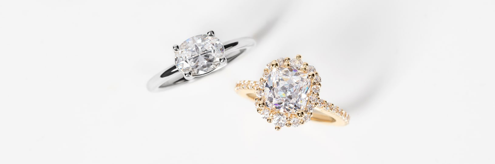 A solitaire and a halo engagement ring