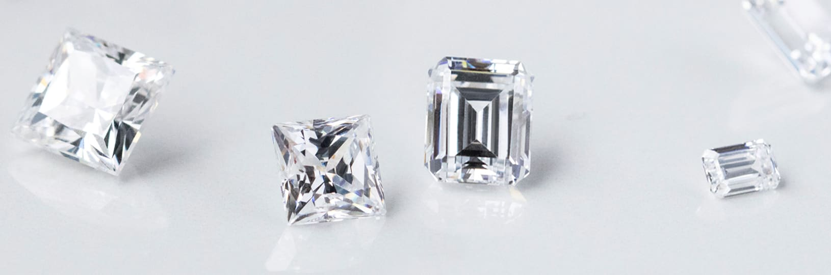 Several loose diamond simulants in different cuts and sizes