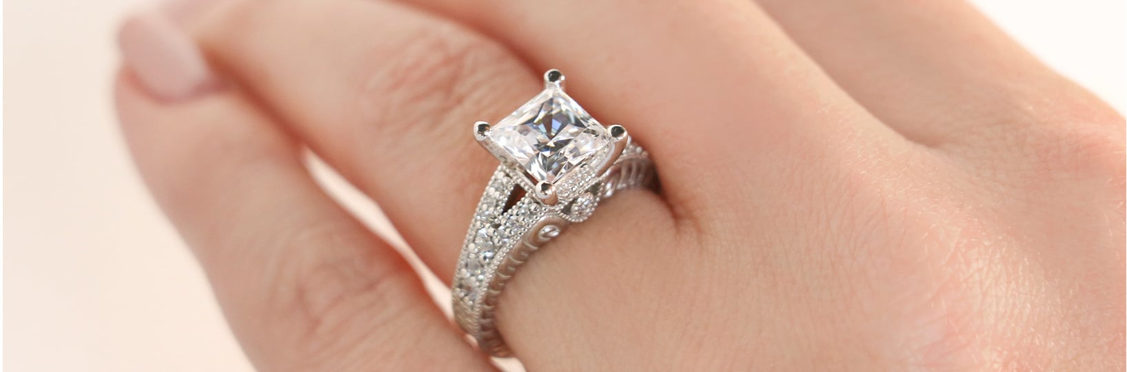 A vintage engagement ring with a princess cut stone
