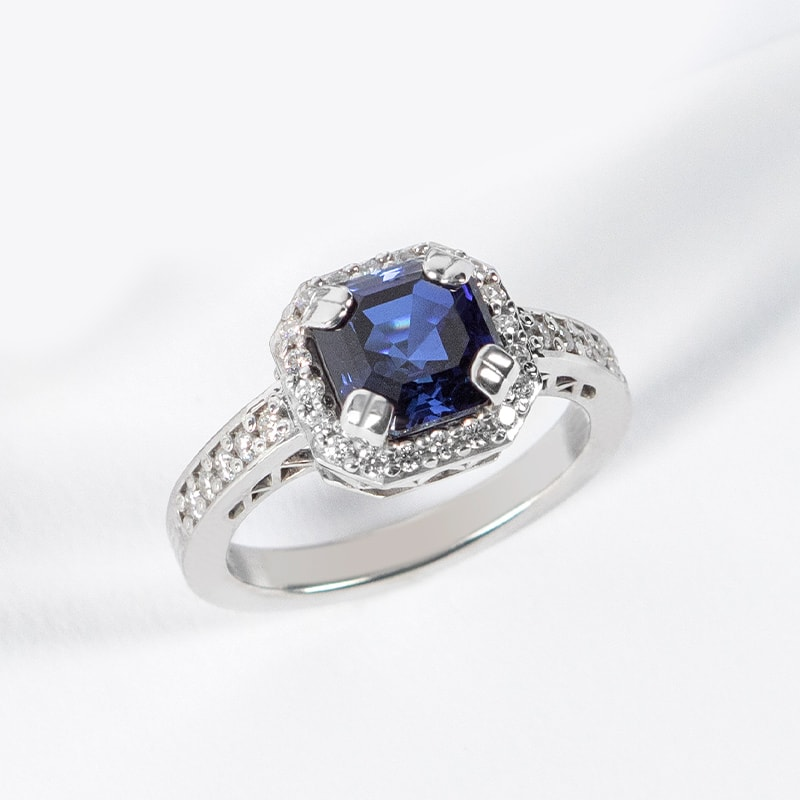 A vintage engagement ring featuring a blue sapphire stone