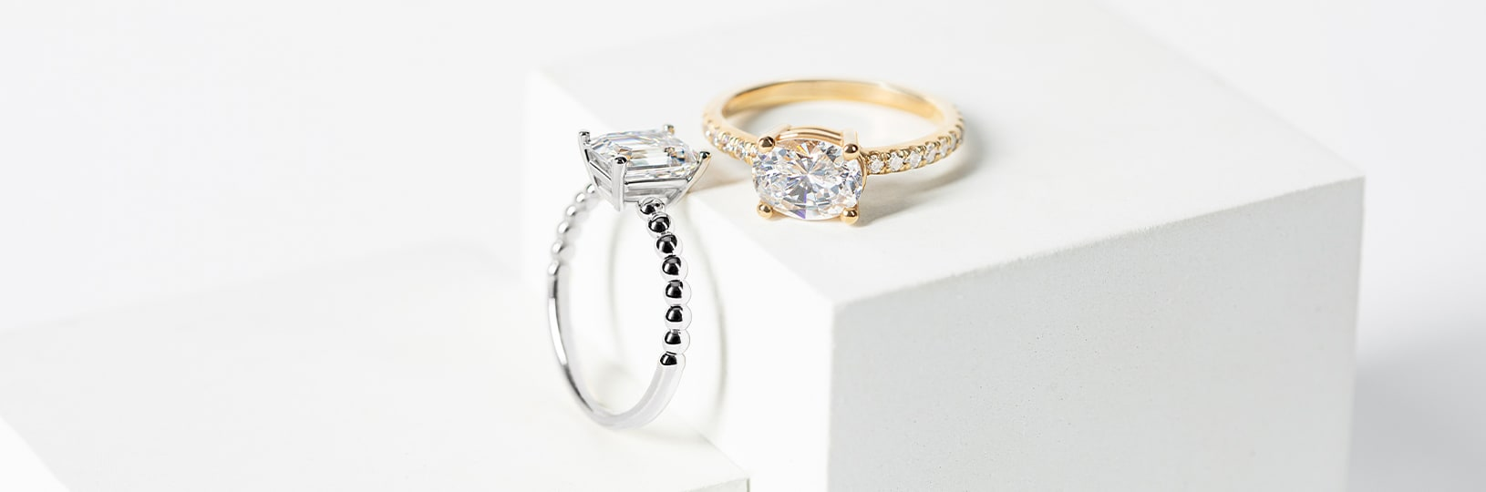 A white gold and a yellow gold engagement ring