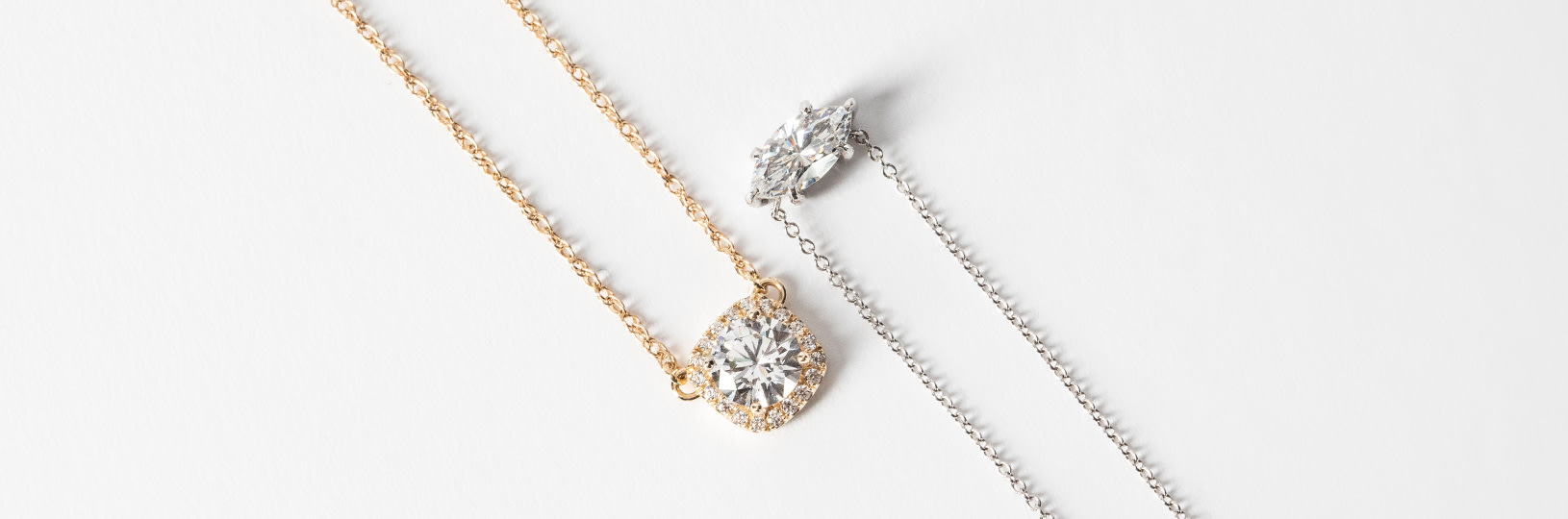Two necklaces, one in yellow gold, the other in white gold