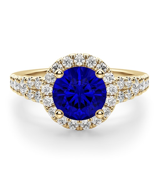 A yellow gold ring with a sapphire center stone